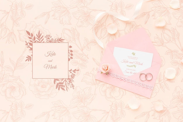 Makieta zaproszenia i obrączki ślubne