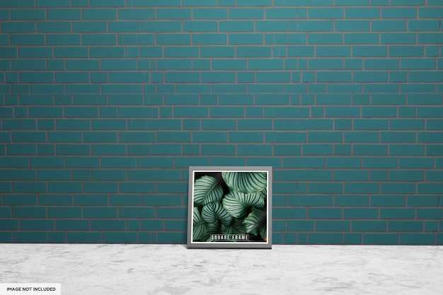 Makieta zdjęć z kwadratową ramką i zieloną ścianą