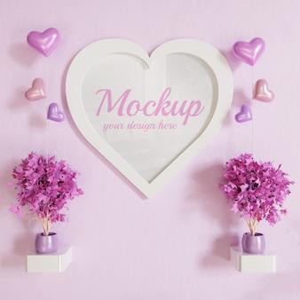Makieta zdjęcie biała ramka w kształcie serca na ścianie z dekoracją roślin i balonami w kształcie serca