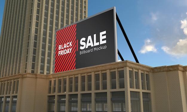 Makieta znaku billboardu na szczycie budynku z banerem sprzedaży w czarny piątek