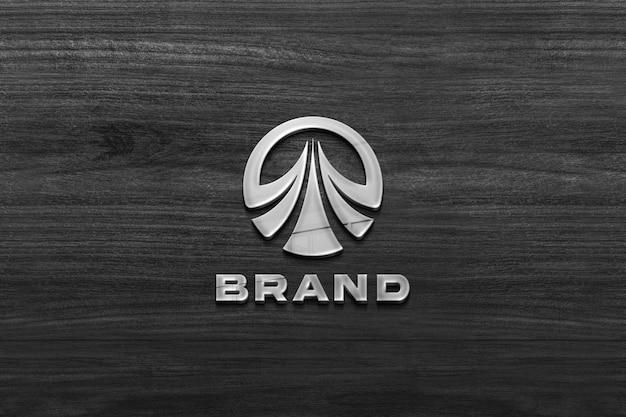 Makieta znaku firmy na drewnianej ścianie