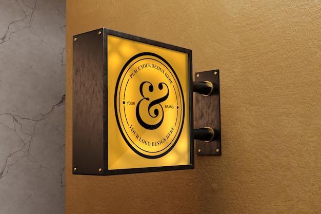 Makieta znaku logo na betonowej ścianie