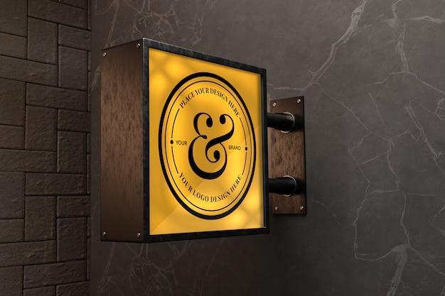Makieta znaku logo na ścianie z czarnego marmuru