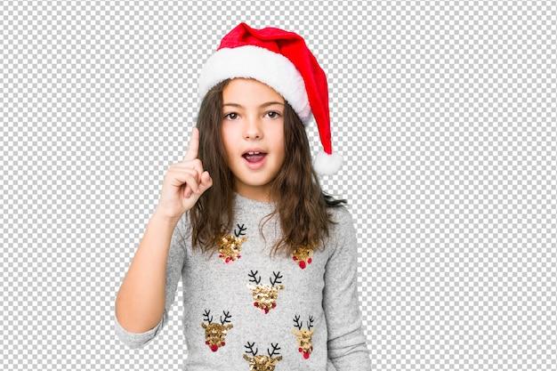 Mała dziewczynka świętuje święto bożęgo narodzenia ma pomysł, inspiraci pojęcie.