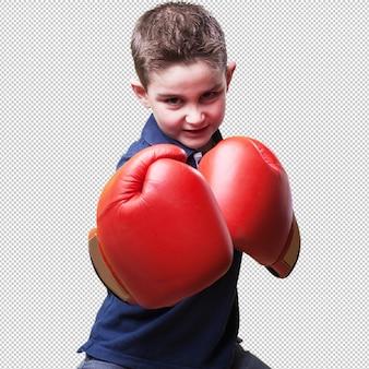 Małe dziecko walczy z czerwonymi rękawicami bokserskimi