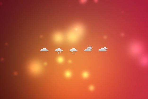 Małe ikony pogody na niewyraźne tło