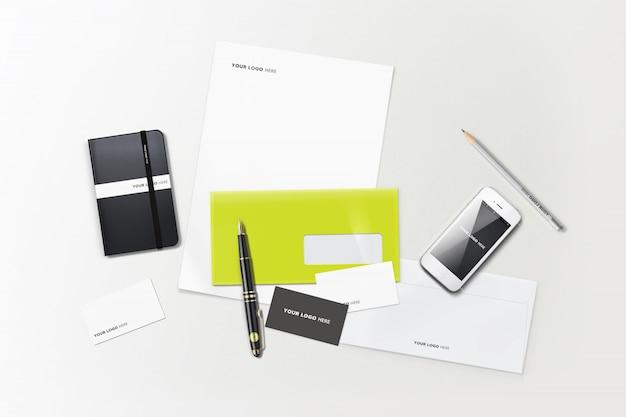 Materiały biurowe makieta książki długopis papier iphone list