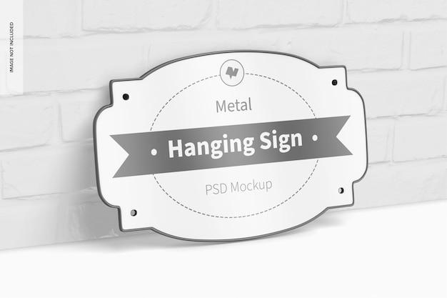Metalowy wiszący znak z makietą sofy