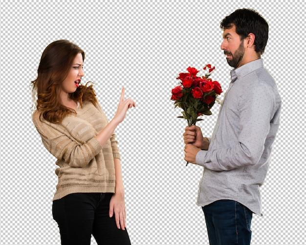 Mężczyzna daje kwiaty dziewczyna