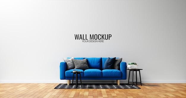 Minimalistyczna makieta ściany wewnętrznej z niebieską sofą