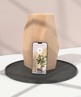 Minimalny wazon i makieta telefonu