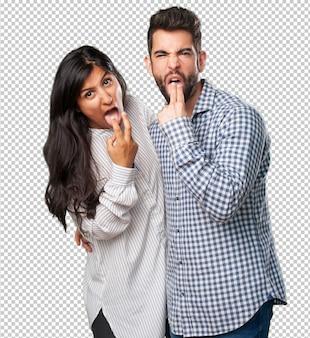 Młoda para robi gest wymioty