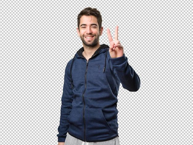 Młody człowiek robi numer dwa gestowi