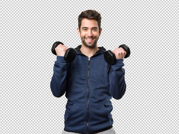 Młody człowiek używa dumbbells