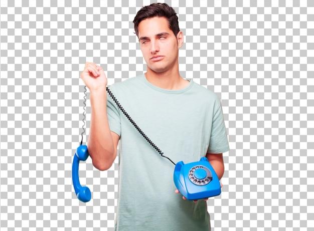Młody przystojny garbnikujący mężczyzna z rocznika telefonem