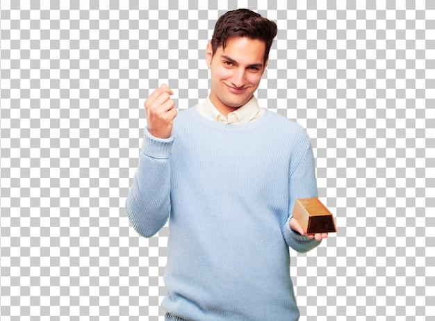 Młody przystojny garbowane człowiek z sztabki złota