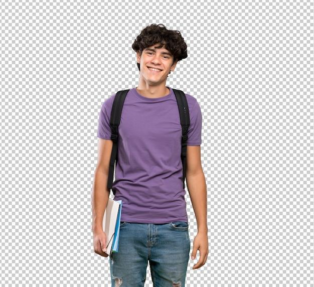 Młody studencki mężczyzna ono uśmiecha się dużo