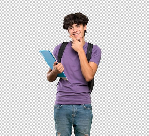 Młody studencki mężczyzna ono uśmiecha się