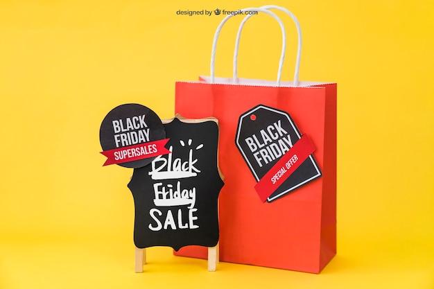 Mockup na czarny piątek z torbą i etykietami