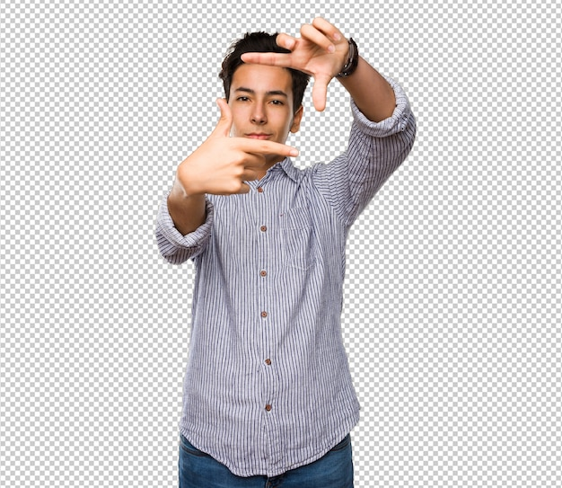 Nastolatek robi gest ramki