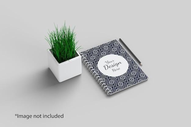 Notatnik makieta widok pod kątem prostym z rośliną