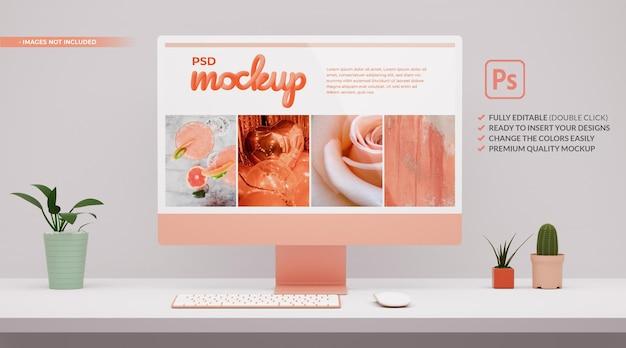 Nowoczesna różowa makieta ekranu komputera na białym pulpicie w renderowaniu 3d