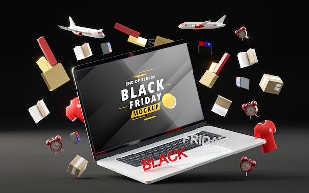 Obiekty 3d i laptop na czarny piątek na czarnym tle