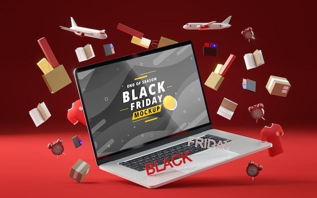 Obiekty 3d i laptop na czarny piątek na czerwonym tle
