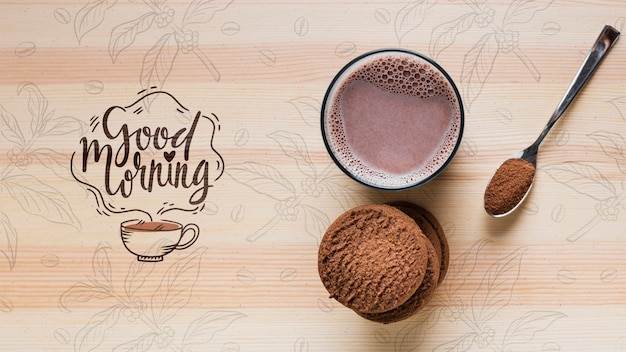 Odgórny widok mleko z kakao na stole