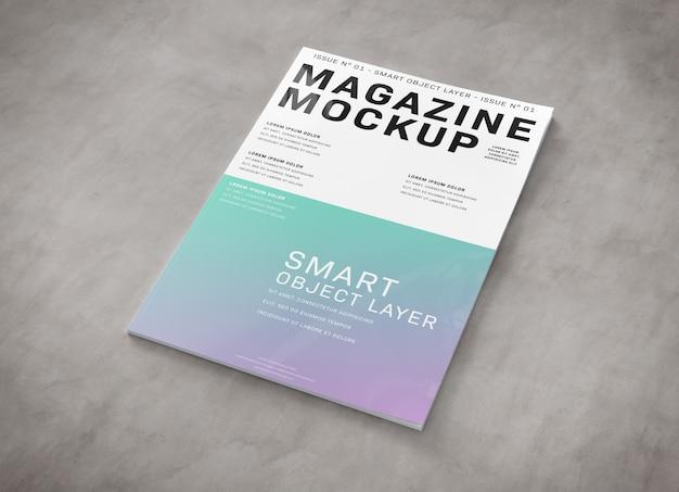 Okładka magazynu na powierzchni betonowej makieta