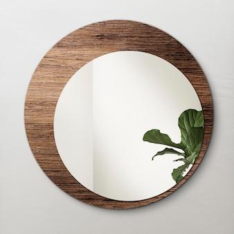 Okrągłe lustro z drewnianym tłem z makietą figi w kształcie liścia