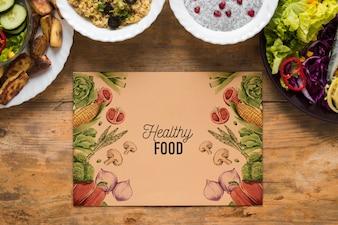 Płaskie ukształtowanie zdrowej żywności z makieta karty