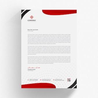 Papier firmowy makieta z czerwonymi falistymi kształtami