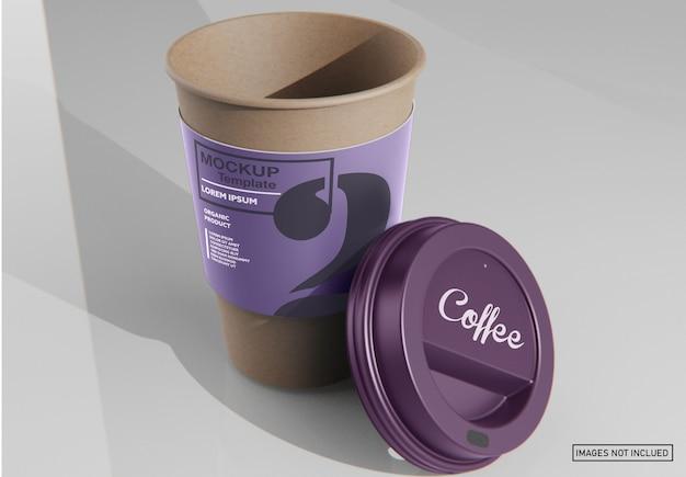 Papierowy kubek kawy z makieta rękawa