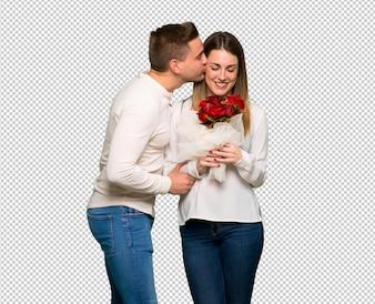 Para w walentynki z kwiatami