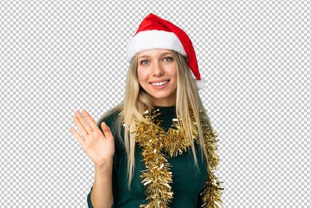 Piękna kobieta z kapeluszem boże narodzenie na białym tle