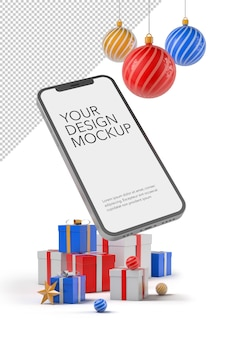 Pionowy obraz smartfona z prezentami i ozdobami świątecznymi wokół, makieta