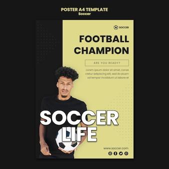 Pionowy plakat do piłki nożnej z męskim graczem