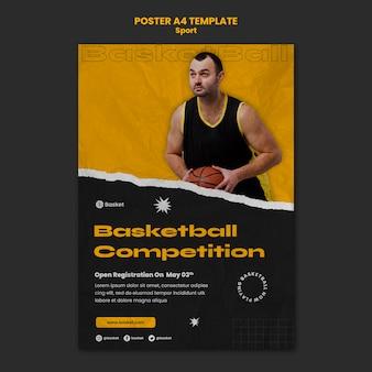 Pionowy plakat na mecz koszykówki z męskim graczem