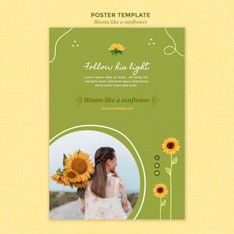 Pionowy szablon plakatu ze słonecznikami i kobietą