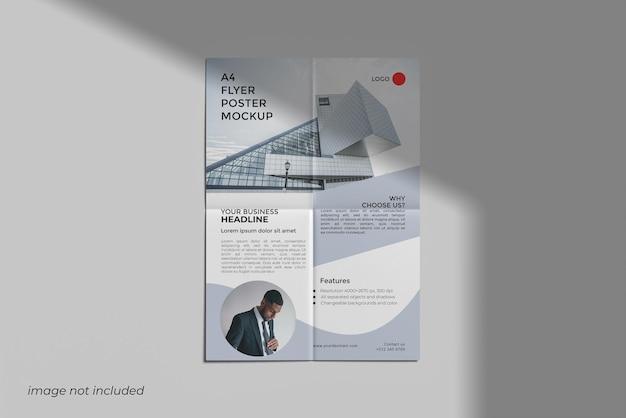Plakat ulotki a4 renderowanie projektu makiety na ścianie