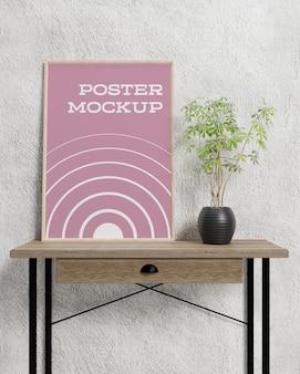 Plakat wewnątrz ramki na zdjęcia na stole makieta wnętrza pokoju