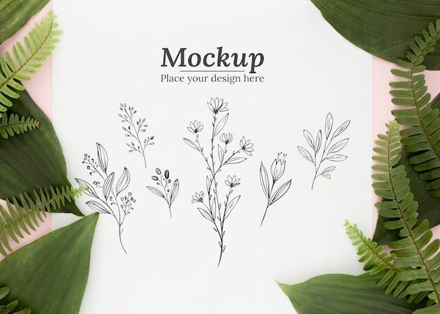 Płaska kompozycja zielonych liści z makietą