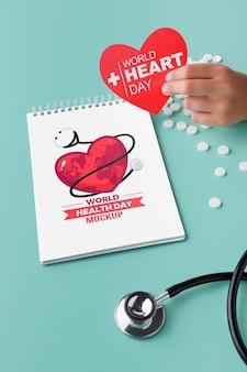 Płaska makieta dnia zdrowia z pigułkami