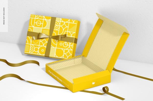 Płaskie słodkie pudełka z makietą wstążki, widok z prawej strony