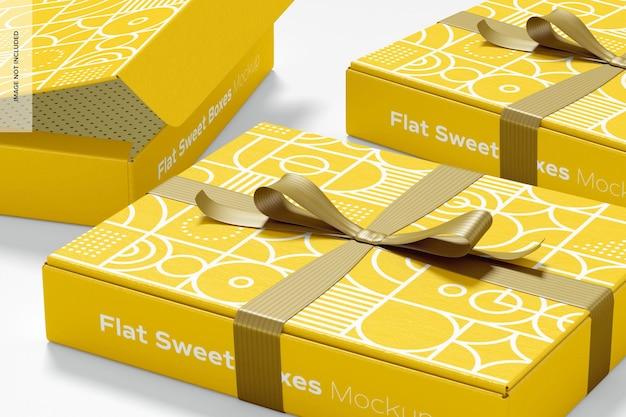 Płaskie słodkie pudełka z makietą wstążki, zbliżenie