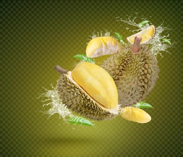 Plusk wody na dojrzałych owocach durian na zielonym tle premium psd