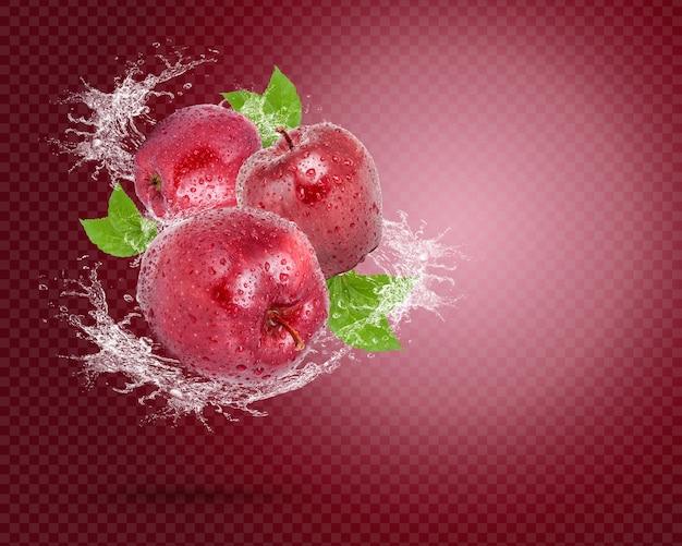 Plusk wody na świeżym czerwonym jabłku z liśćmi na czerwonym tle premium psd