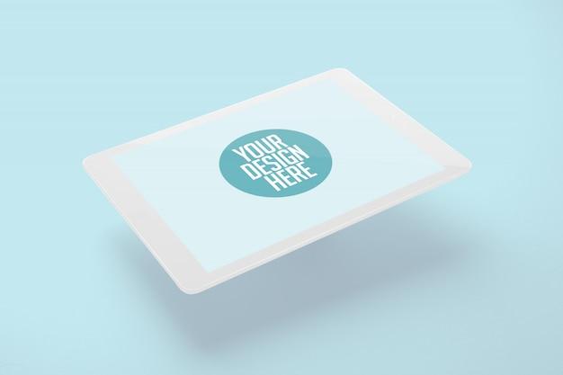 Pływający biały tablet makieta na białym tle na światło niebieskie tło
