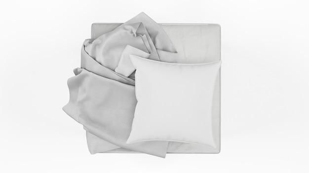 Poduszka w szarym kolorze i pojedyncze strzępy materiału, widok z góry